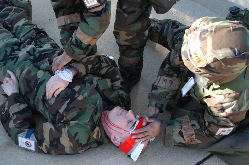 A US Air Force (USAF) AIRMAN with the 131st Fighter Wing (FW) gives aid to an explosion victim during a 131st Fighter Wing (FW) Operational Readiness Exercise (ORE) at the Combat Readiness Training Center (CRTC), Gulfport, Mississippi (MS)
