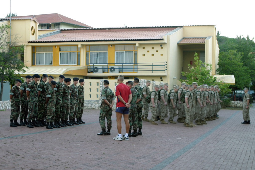A platoon size element of Royal Dutch Marines from the First Infantry Company (left) stands in formation next to a platoon size element of US Marine Corps Reserve (USMCR) Marines assigned to Kilo Company, 3rd Battalion, 25th Marines, during the Opening Ceremony for the Dutch Bilateral Training Exercise 2004, at Marine Base Parera, Curacao. The Exercise is an annual cooperative exchange between the USMCR and the Royal Netherlands Marine Corps where differing ideas and tactics are discussed and used in a field environment