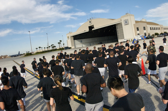 """US Air Force (USAF) personnel at MacDill Air Force Base (AFB), Florida (FL), from the 6th Air Mobility Wing (AMW) and tenant unit teams participate in the """"Fit to Fight"""" 2 mile run on the flight line"""