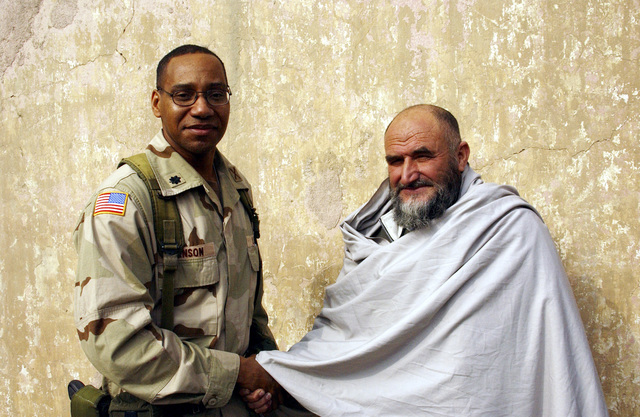 US Army (USA) Lieutenant Colonel (LTC) Dexter Henson, Director of Information Operations for Coalition Joint Task Force 180 (CJTF-180) shakes the hand of General Akber Gharzai, the tribal leader of Nooristan, after their meeting at the city of Kabul, Afghanistan. The purpose of the meeting is to facilitate better relations between the people of Nooristan, Afghanistan and CJTF-180, supporting Operation ENDURING FREEDOM