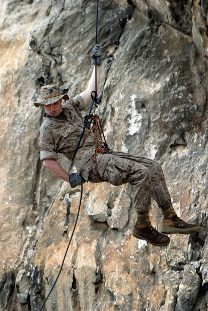 US Marine Corps Reserve (USMCR) Lance Corporal (LCPL) Andrew Thomas, a rifleman with Kilo Company, 3rd Battalion, 25th Marines (Kilo 3/25), rappels down the wall of a cliff on the island of Curacao during the Dutch Bilateral Training Exercise 2004, at Marine Base Parera, Curacao. The Exercise is an annual cooperative exchange between the USMCR and the Royal Netherlands Marine Corps where differing ideas and tactics are discussed and used in a field environment