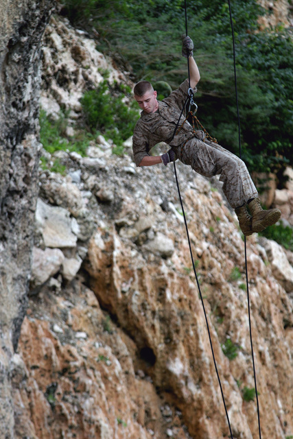 US Marine Corps Reserve (USMCR) Lance Corporal (LCPL) Justin McCrory, Rifleman, Kilo Company (K CO), 3rd Battalion, 25th Marines (3/25), rappels down a cliff during a rappelling exercise on the island of Curacao during DUTCH BILATERAL TRAINING 2004. The Dutch Bilateral Training is an annual cooperative exchange between the US Marine Corps Reserves (USMCR) and the Royal Netherlands Marine Corps where differing ideas and tactics are discussed and tested in a field environment