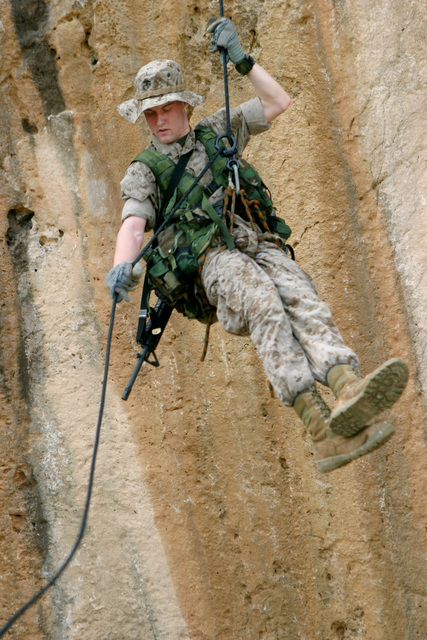 US Marine Corps Reserve (USMCR) Lance Corporal (LCPL) Nathan Carpenter, a rifleman with Kilo Company, 3rd Battalion, 25th Marines (Kilo 3/25), rappels down the wall of a cliff on the island of Curacao during the Dutch Bilateral Training Exercise 2004, at Marine Base Parera, Curacao. The Exercise is an annual cooperative exchange between the USMCR and the Royal Netherlands Marine Corps where differing ideas and tactics are discussed and used in a field environment