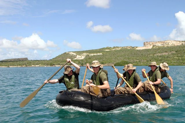 US Marine Corps Reserve (USMCR) Marines assigned Kilo Company, 3rd Battalion, 25th Marines (Kilo 3/25), paddle a combat rubber reconnaissance rafts during a squad competition during the Dutch Bilateral Training Exercise 2004, at Marine Base Parera, Curacao. The Exercise is an annual cooperative exchange between the USMCR and the Royal Netherlands Marine Corps where differing ideas and tactics are discussed and used in a field environment