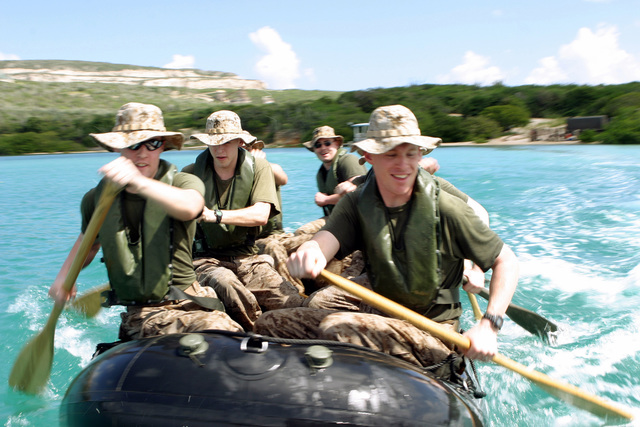 US Marine Corps (USMC) Marines with Kilo Company (K CO), 3rd Battalion, 25th Marines (3/25), using a Royal Dutch Marine combat rubber reconnaissance crafts race in a squad competition on the island of Curacao during DUTCH BILATERAL TRAINING 2004. The Dutch Bilateral Training is an annual cooperative exchange between the US Marine Corps Reserves (USMCR) and the Royal Netherlands Marine Corps where differing ideas and tactics are discussed and tested in a field environment