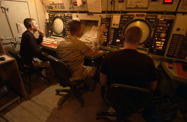 US Air Force (USAF) Air Traffic Controller (ATC), SENIOR AIRMAN (SRA) Philip Fox, left, 447th Air Expeditionary Operations (AEO), manages the air traffic flow through Baghdad International Airport (BIA), using a TPN 19 radar system, Iraq (IRQ), in support of Operataion IRAQI FREEDOM