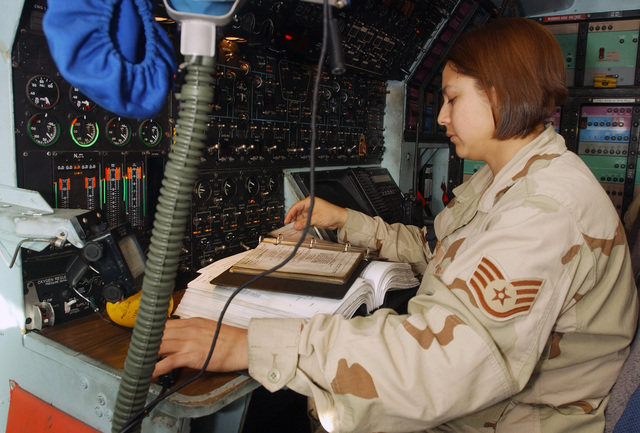 US Air Force (USAF) SSGT Raquel Ferrel, a C-5 Galaxy aircraft Crew CHIEF with the 447th Aircraft Maintenance Squadron (AMXS), reviews an avionics maintenance Technical Order (TO) at the Baghdad International Airport (BIA), Iraq (IRQ), in support of Operation IRAQI FREEDOM