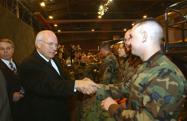 "Vice President of the United States of America Richard Bruce ""Dick"" Cheney pays a visit to the US Air Force (USAF) Airmen gathered at a Hanger on the Aviano Air Base (AB) flight line, during his brief stopover in Italy (ITA)"