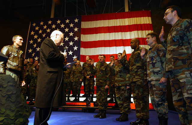 "Vice President of the United States of America Richard Bruce ""Dick"" Cheney pays a visit and swears-in re-enlisting US Air Force (USAF) Airmen gathered at a Hanger on the Aviano Air Base (AB) flight line, during his brief stopover in Italy (ITA)"