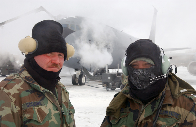 In freezing weather, US Air Force (USAF) Crew Chiefs Technical Sergeant (TSGT) Tim Goehring and MASTER Sergeant (MSGT) Rick Erwin, both with the 185th Air Refueling Wing (ARW), Iowa Air National Guard (ANG), Sioux City, Iowa (IA)