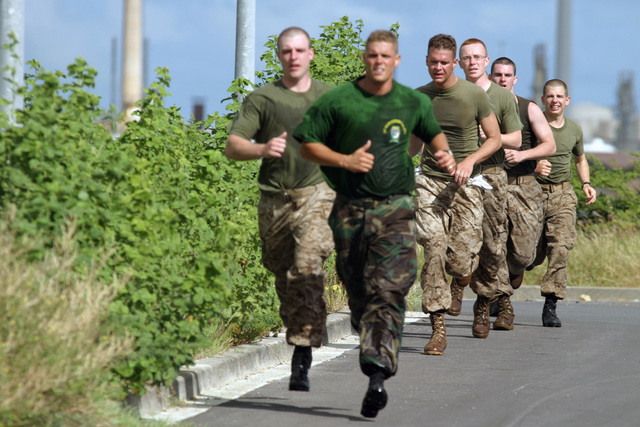 Royal Netherlands Marine Corps (Royal Dutch Marines) and US Marine Corps Reserve (USMCR) Marines assigned to Kilo Company, 3rd Battalion, 25th Marines (Kilo 3/25), participate in the Nassau Run during squad competition, as part of the Dutch Bilateral Training Exercise 2004, at Marine Base Parera, Curacao. The Exercise is an annual cooperative exchange between the USMCR and the Royal Netherlands Marine Corps where differing ideas and tactics are discussed and used in a field environment