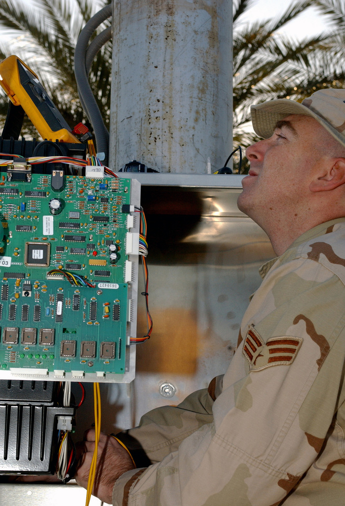 US Air Force (USAF) SENIOR AIRMAN (SRA) Michael Doherty assigned to the 447th Expeditionary Communications Squadron (ECS), performs a weekly preventive maintenance inspection on the Whelen Giant Voice base public address system utilized during attacks and emergency response situations at the Baghdad International Airport (BIA), in support of Operation IRAQI FREEDOM