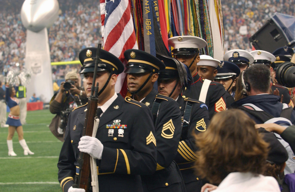 US Air Force (USAF) personnel from the Texas National Guard's Joint Color Guard stand at attention prior to presenting the colors during pregame ceremonies at SUPERBOWL XXXVIII (38), in the Houston Astrodome, Texas (TX)