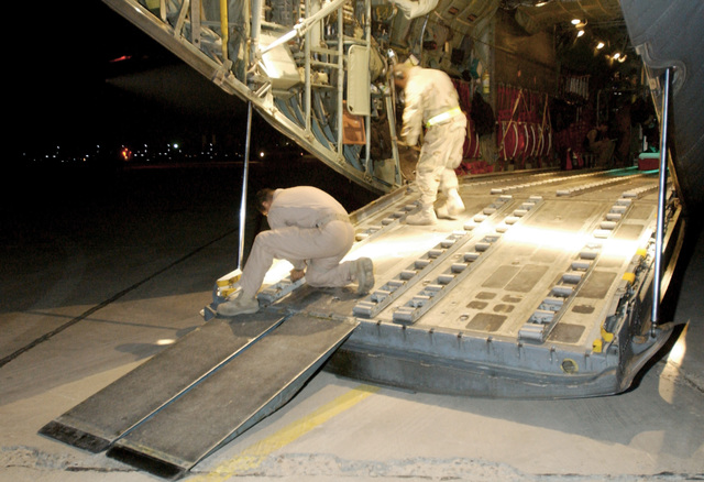 The US Air Force (USAF) 447th Expeditionary Readiness Squadron (ELRS), Aerial Port Specialists load cargo pallets onboard a C-130 Hercules cargo plane at Baghdad International Airport (BIA), Iraq (IRQ), in support of Operation IRAQI FREEDOM