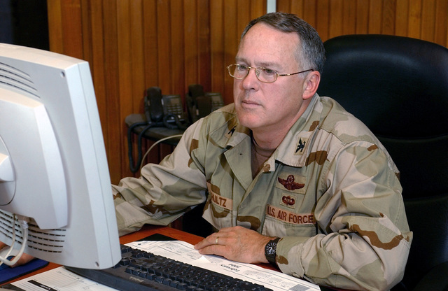 US Air Force (USAF) Colonel (COL) Robert G. Schultz, the new commander of the 447th Air Expeditionary Group (AEG), prepares for an interview at Baghdad International Airport (BIA), Iraq (IRQ), in support of Operation IRAQI FREEDOM