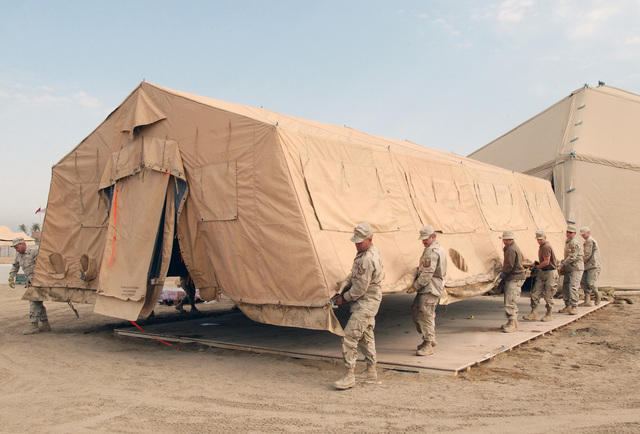 US Air Force (USAF) 447th Expeditionary Civil Engineer Squadron (ECES) disassembles the 447th Expeditionary Services Squadron (ESS) clamshell tent recreation center at Baghdad International Airport (BIA), Iraq (IRQ), in support of Operation IRAQI FREEDOM