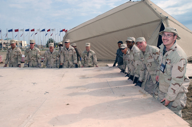 US Air Force (USAF) personnel with the 447th Expeditionary Civil Engineer Squadron (ECES) disassembles the 447th Expeditionary Services Squadron (ESS) clamshell tent recreation center at Baghdad International Airport (BIA), Iraq (IRQ), in support of Operation IRAQI FREEDOM