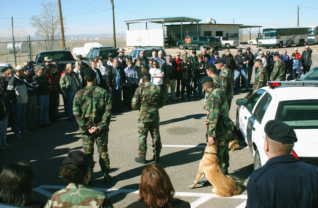 At the US Air Force (USAF) 377Th Security Police Squadron (SPS) reunion, Lieutenant Colonel (LCOL) Keith Harris, 377th Security Forces Squadron (SFS) Commander, introduces a military working dog demonstration to the 36-year reuion group. Personnel from the 377th SPS fought-off Communist Forces who infiltrated Tan Son Nhut Air Base (AB), Vietnam (VNM) during the Tet Offensive of 1968