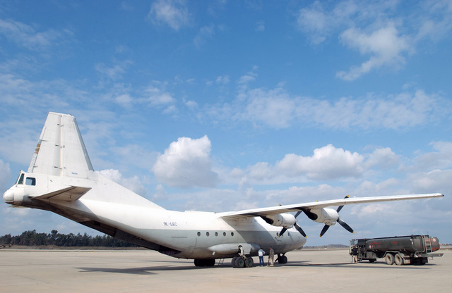 The US Air Force (USAF) 447th Expeditionary Readiness Squadron (ELRS), Fuel Specialists refuel a Russian Antonov An-12 Military Transport Aircraft (MTA) at Baghdad International Airport (BIA), Iraq (IRQ), in support of Operation IRAQI FREEDOM