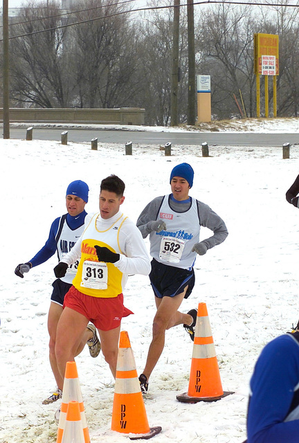 US Marine Corps (USMC) GUNNERY Sergeant (GYSGT) Jeff M. Klemmer (foreground) a member of the All Marine Cross Country Team, participates in the men's 4k race during the Winter Armed Forces Cross-Country Championship held at Indianapolis, Indiana (IN)