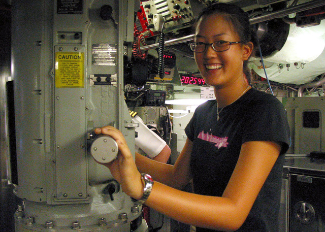 Ladies Professional Golfers Association (LPGA) (Amateur) Miss Michelle Wie, poses for a photograph aboard the US Navy (USN) LOS ANGELES CLASS: Attack Submarine, USS HONOLULU (SSN 718), at Pearl Harbor, Hawaii (HI). The teenage Hawaiian native, golf star, toured the ship and had lunch with members of the crew
