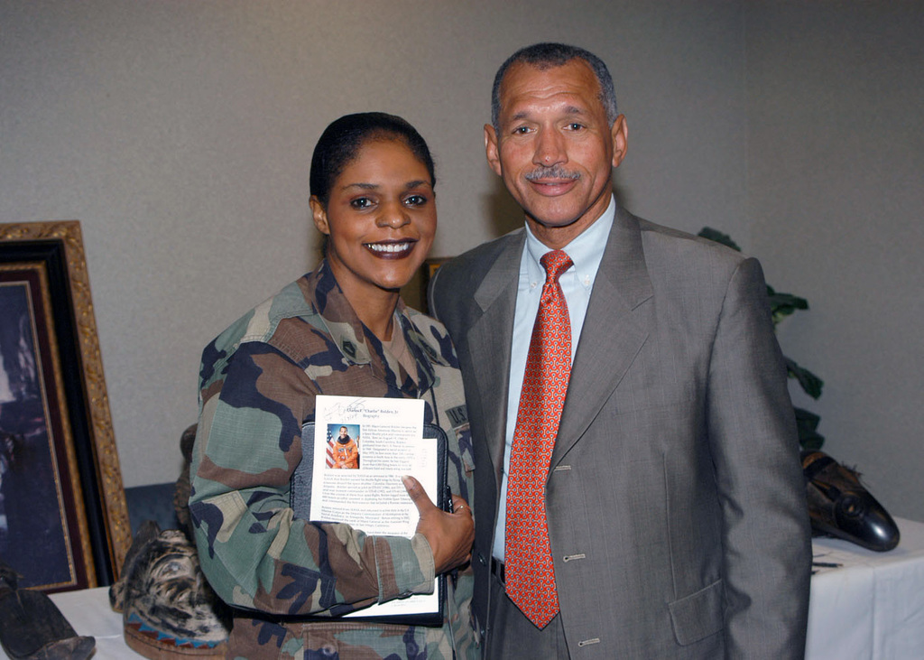 U.S. Marine Corps MAJ. GEN., retired, Charles Bolden, Jr. (right) spends time with U.S. Army MASTER SGT. Pagan along with other soldiers of the U.S. Southern Command (USSOUTHCOM) during African American history month. GEN. Bolden's many accomplishments include being the first African American Marine to serve as a Space Shuttle pilot and commander for NASA, he flew four missions aboard the space shuttles Columbia, Discovery and Atlantis. He also assisted in deploying the Hubble Space Telescope and was a U.S. Navy aviator with more than 100 combat missions in South Asia. General Bolden also served as Deputy Commandant of Midshipmen at the U. S. Naval Academy. (U.S. Army PHOTO by Chris...