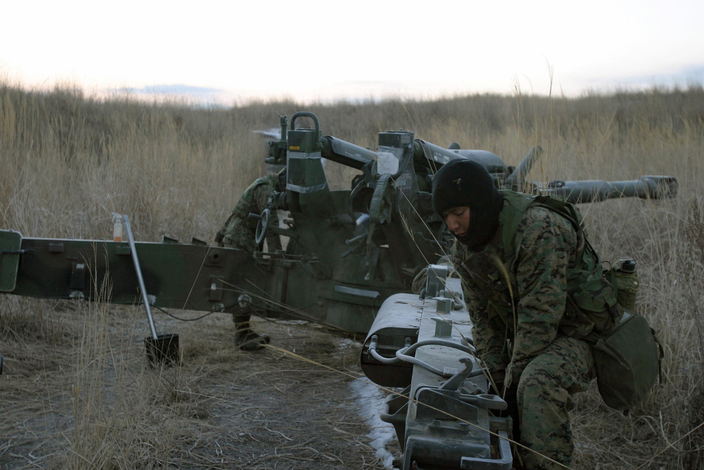 US Marine Corps (USMC) Lance Corporal (LCPL) Elvis Gutierrez, Gun One, Kilo Battery, 3rd Battalion (BN), 10th Marine Regiment, 2nd Marine Division (MAR DIV), works on an M198 155mm Towed Howitzer during a field operation in the North Fuji Training Area as part of Fuji Combined Arms Operation FY-04-2