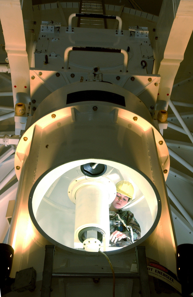 US Air Force (USAF) AIRMAN First Class (A1C) Janina Kowalski, a Ground Radar Systems Maintenance Apprentice from the 30th Space Communications Squadron (SCS) inspects the interior of a Next Generation Radar (NGR) at Vandenberg Air Force Base (AFB), California (CA)