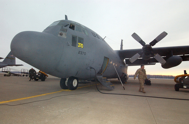 US Air Force (USAF) Technical Sergeant (TSGT) Tony Cilluffo, Crew CHIEF with the 191st Maintenance Squadron (MXS) takes an inspection stroll around a C-130 Hercules cargo aircraft just prior to take off. (SUBSTANDARD)