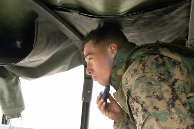 US Marine Corps (USMC) Corporal (CPL) Johnathon Huizar, Kilo Battery, 3rd Battalion (BN), 10th Marine Regiment, 2nd Marine Division (MAR DIV), takes time out to shave during a field operation in the North Fuji Training Area as part of Fuji Combined Arms Operation FY-04-2