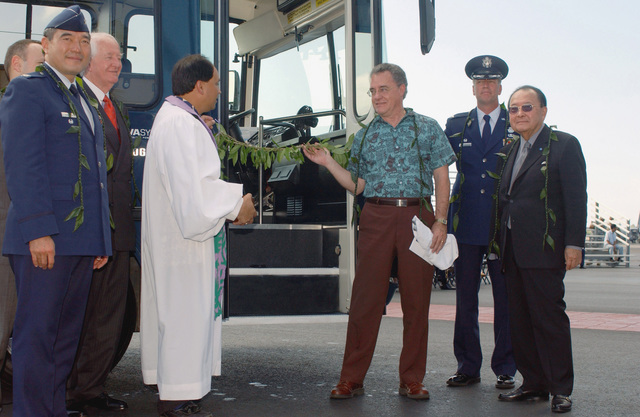 Left to right, US Air Force (USAF) Colonel (COL) David Nakayama, Chaplain Carl Perry Kahu Kordell Kekoa, Doctor Philip Bossert, COL Raymond Torres, the 15th Air Base Wing (ABW) Commander and The Honorable Senator Daniel Inouye for Hawaii (HI), remove the ceremonial maile lei which represents growth, during a ribbon cutting ceremony for a new fuel-efficient Hydrobus at Hickam Air Force Base (AFB)