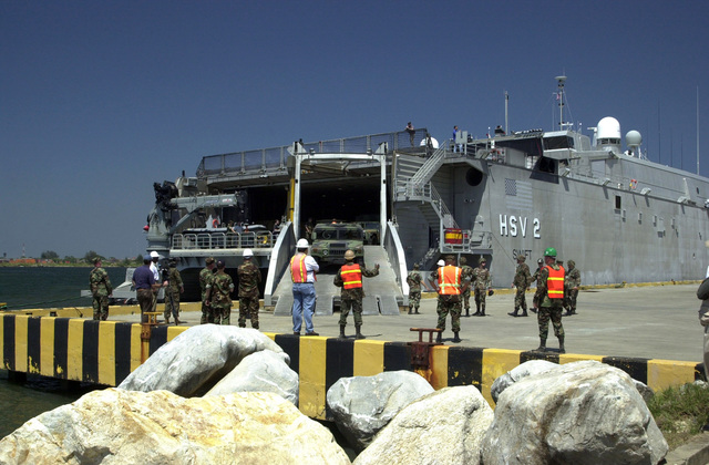 """A U.S. Army M-998 High-Mobility Multipurpose Wheeled Vehicle (HMMWV) is off-loaded from the U.S. Navy High Speed Vessel (HSV) 2""""Swift""""at Puerto Cortes, Honduras, on Feb. 23, 2004, in support of New Horizons 04 during the Joint Logistics Over-the-Shore (JLOTS) Exercise.  JLOTS is overseen by the U.S. Transportation Command and consists of the loading and off-loading of ships in the area of underdeveloped ports.  (U.S. Army photo by Kaye Richey) (Released)"""