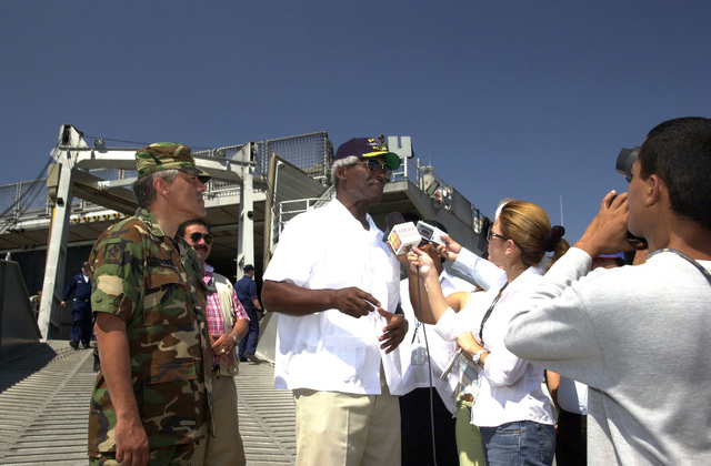 """The Honorable Larry Palmer (white shirt), U.S. Ambassador to Honduras, is interviewed by the Honduran Press while onboard the High Speed Vessel (HSV) 2""""Swift""""at Puerto Cortes, Honduras, on Feb. 24, 2004, in support of New Horizons 04 during the Joint Logistics Over-the-Shore (JLOTS) Exercise.  The Army of Honduras (Ejercito de Honduras-EH) COL. Efraim Ochoa Aviles (left), Commander, 105th Infantry Brigade, is also present in the photograph.  JLOTS is overseen by the U.S. Transportation Command and consists of the loading and off-loading of ships in the area of underdeveloped ports.  (U.S. Army photo by Kaye Richey) (Released)"""