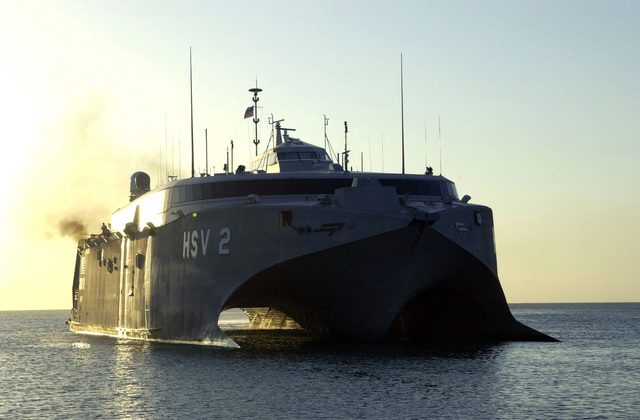 """The U.S. Navy High Speed Vessel (HSV) 2""""Swift""""arrives at Puerto Cortes, Honduras, on Feb. 23, 2004, to off-load U.S. Army vehicles in support of New Horizons 04 during the Joint Logistics Over-the-Shore (JLOTS) Exercise.  JLOTS is overseen by the U.S. Transportation Command and consists of the loading and off-loading of ships in the area of underdeveloped ports.  (U.S. Army photo by Kaye Richey) (Released)"""