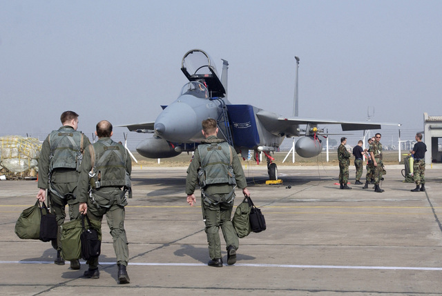 Three US Air Force (USAF) F-15 Strike Eagle pilots from Elmendorf Air Force Base (AFB), Alaska (AK) with the 19th Fighter Squadron (FS) walk toward their aircraft to fly sorties with the Indian Air Force (IAF) at Gwalior Air Force Station (AFS), India (IND)