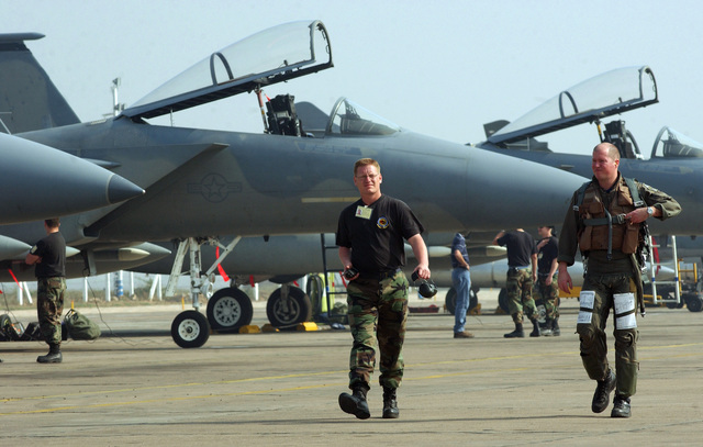 US Air Force (USAF) Technical Sergeant (TSGT) Bryan Koch, left, talks with Captain (CAPT) Mark Snowden after returning from a sortie in support of exercise Cope India 04 at Gwalior Air Station, India (IND)