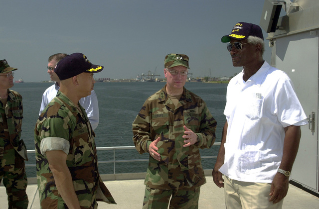 """U.S. Army MAJ. GEN. William Crupe (center, right), Commander, 143rd Transportation Command, Orlando, Fla., speaks with the Honorable Larry Palmer (right), U.S. Ambassador to Honduras, and U.S. Navy CMDR. Clark Price, Jr. (center, left), Commander, High Speed Vessel (HSV) 2""""Swift""""aboard the vessel at Puerto Cortes, Honduras, on Feb. 24, 2004, in support of New Horizons 04 during the Joint Logistics Over-the-Shore (JLOTS) Exercise.  JLOTS is overseen by the U.S. Transportation Command and consists of the loading and off-loading of ships in the area of underdeveloped ports.  (U.S. Army photo by Kaye Richey) (Released)"""