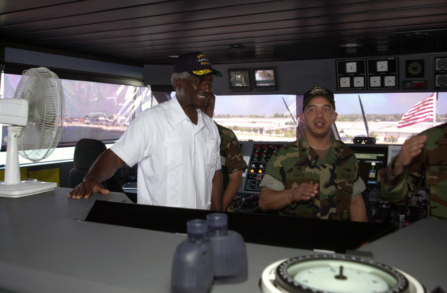 """U.S. Navy CMDR. Clark Price, Jr. (right), Commander, High Speed Vessel (HSV) 2""""Swift""""gives the Honorable Larry Palmer (left), U.S. Ambassador to Honduras, a tour of the bridge aboard the High Speed Vessel (HSV) 2""""Swift""""at Puerto Cortes, Honduras, on Feb. 24, 2004, in support of New Horizons 04 during the Joint Logistics Over-the-Shore (JLOTS) Exercise.  JLOTS is overseen by the U.S. Transportation Command and consists of the loading and off-loading of ships in the area of underdeveloped ports.  (U.S. Army photo by Kaye Richey) (Released)"""