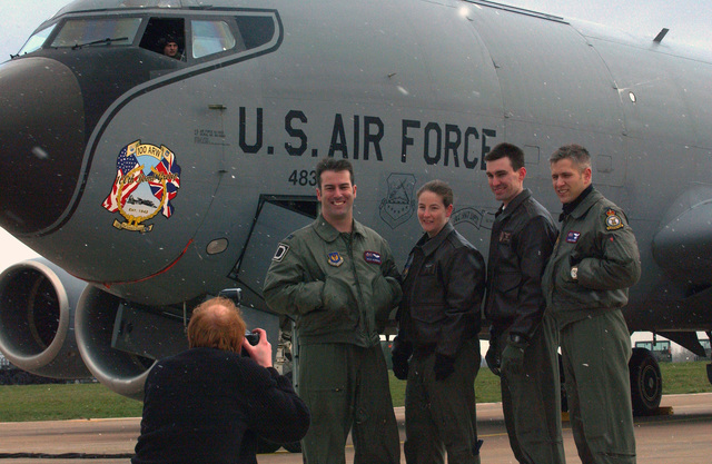 A US Air Force (USAF) aircrew with the 100th Air Refueling Wing (ARW), poise for the local media by their KC-135 Stratotanker at Royal Air Force (RAF) Fairford, England (ENG), during a temporary stay. The stay will end once their home runway at RAF Mildenhall is reconstructed