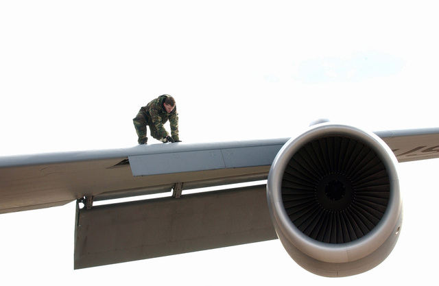 A US Air Force (USAF) maintenance team AIRMAN from the 100th Air Refueling Wing (ARW), conducts a routine inspection of a KC-135 Stratotanker at Royal Air Force (RAF) Fairford, England (ENG), during a temporary stay. The stay will end once their home runway at RAF Mildenhall is reconstructed