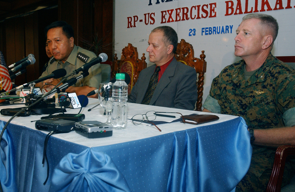 Armed Forces of the Philippines (AFP), Philippine Army (PA) Brigadier General (BGEN) Rafael Romera (far left), AFP Exercise BALIKATAN 2004 Co-Director; AFP, PA General (GEN) Narciso Abaya (second from left and leaning forward), CHIEF of STAFF, AFP (CSAFP); the Honorable Mr. Joseph Mussomeli (second from right), Deputy CHIEF of Mission, Embassy of the United States in Manila; and US Marine Corps (USMC) Brigadier General (BGEN) Kenneth Glueck (right), US Exercise BALIKATAN 2004 Co-Director; hold a press conference at Clark Air Base (AB), Luzon Island, Philippines (PHL), to answer questions aling with Exercise BALIKATAN 2004, which is a regularly scheduled joint interoperability exercise...