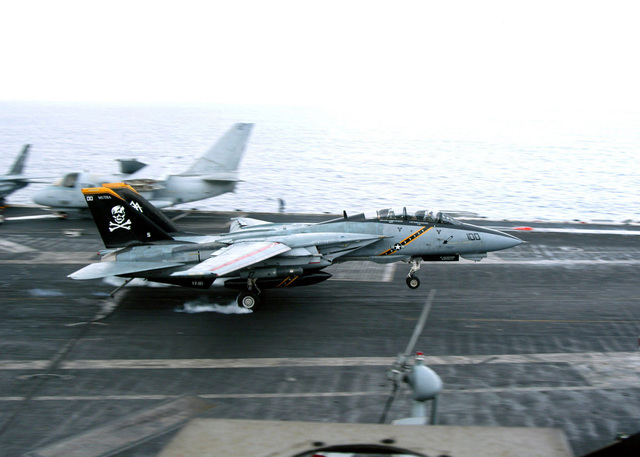 A US Navy (USN) F-14 Tomcat fighter aircraft, Fighter Squadron 103 (VF-103), Jolly Rogers, Naval Air Station (NAS) Oceana, Virginia (VA), makes an arrested landing on the flight deck aboard USS JOHN F. KENNEDY (CV 67). The KENNEDY and her Carrier Strike Group (CSG) are conducting a Composite Training Unit Exercise (COMPTUEX) in preparation for an upcoming deployment