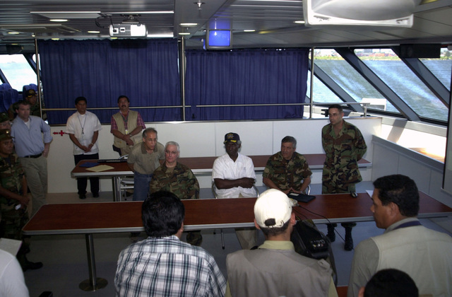 """The Honorable Larry Palmer (center, white shirt), U.S. Ambassador to Honduras, attends a press conference with members of the Honduran Press while touring the U.S. Navy High Speed Vessel (HSV) 2""""Swift""""dock at Puerto Cortes, Honduras, on Feb. 24, 2004, in support of New Horizons 04 during the Joint Logistics Over-the-Shore (JLOTS) Exercise.  JLOTS is overseen by the U.S. Transportation Command and consists of the loading and off-loading of ships in the area of underdeveloped ports.  (U.S. Army photo by Kaye Richey) (Released)"""