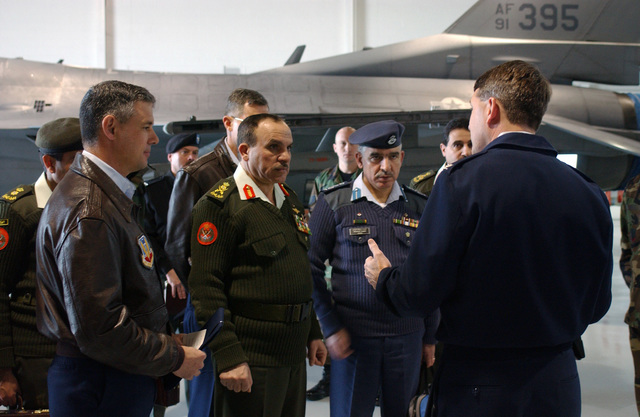 US Air Force (USAF) Colonel (COL) Michael Walters, the 20th Maintenance Group (MXG) Commander, at Shaw Air Force Base (AFB), South Carolina (SC), briefs Jordanian General (GEN) Khalid Al Sarayrah, second from left, Chairman Joint Chiefs of STAFF (CJCS) Jordanian Armed Forces (JAF), at the base's Weapons Standardization Facility (WSF). USAF Colonel (COL) Sam Angelella, left, the 20th Fighter Wing (FW) Commander, looks on during the visit