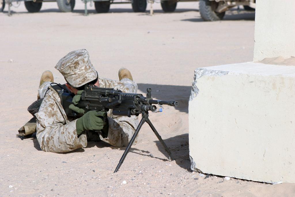 US Marine Corps (USMC) Lance Corporal (LCPL) Martin Holtzman, Kilo Company (K Co), 1ST Platoon (PLT), 3rd Battalion (BN), 4th Marines (3/4), 1ST Marine Division (MARDIV), Marine Corps Base (MCB) Camp Pendleton, California (CA), provides security while conducting patrolling exercises at Camp Udairi, Kuwait (KWT) during Operation IRAQI FREEDOM