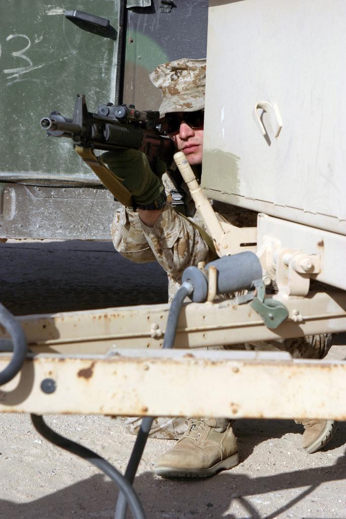 US Marine Corps (USMC) Lance Corporal (LCPL) Miguel Hernandez, Kilo Company (K Co), 1ST Platoon (PLT), 3rd Battalion (BN), 4th Marines (3/4), 1ST Marine Division (MARDIV), Marine Corps Base (MCB) Camp Pendleton, California (CA), provides security while conducting patrolling exercises at Camp Udairi, Kuwait (KWT) during Operation IRAQI FREEDOM
