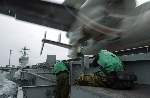 US Navy (USN) Photographer's Mate AIRMAN (PHAN) Criag Spiering photographs a USN E2-C Hawkeye, Carrier Airborne Early Warning Squadron (VAW-124), Bear Aces, Naval Air Station (NAS) Norfolk, Virginia (VA), launching off the bow of the USS HARRY S. TRUMAN (CVN 75). The TRUMAN is currently undergoing carrier qualifications and flight deck certification off the Atlantic coast