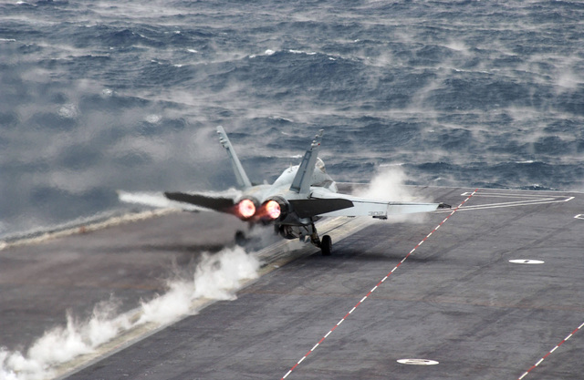 A US Navy (USN) F/A-18C Hornet fighter aircraft, Strike Fighter Squadron 87 (VFA-87), Golden Warriors, Naval Air Station (NAS) Oceana, Virginia (VA), takes off from the flight deck of Nimitz Class Aircraft Carrier USS HARRY S. TRUMAN (CVN 75). The TRUMAN is currently undergoing carrier qualifications and flight deck certification off the Atlantic coast