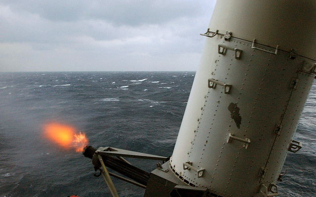 Flames project from the rotating 20 mm gun barrels of the M-61A1 Gatling Gun of the MK 15 Phalanx Close-In Weapons System (CIWS) as it is fired during a Close-in Weapons System Practice Fire (CIWS PACFIRE) evolution onboard the USN Nimitz Class Aircraft Carrier USS HARRY S. TRUMAN (CVN 75). The TRUMAN is currently undergoing carrier qualifications and flight deck certification off the Atlantic coast