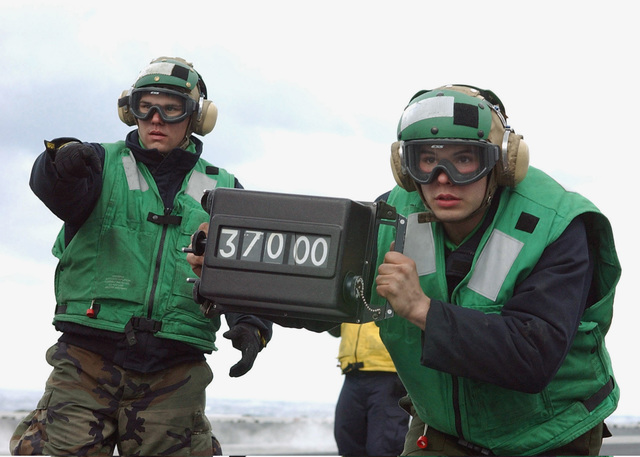 US Navy (USN) Sailors show the flight deck handlers the weight of an aircraft before it is launched off the flight deck of the USN Nimitz Class Aircraft Carrier USS HARRY S. TRUMAN (CVN 75). The TRUMAN is currently undergoing carrier qualifications and flight deck certification off the Atlantic coast